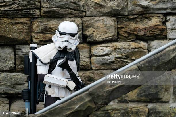 Stormtrooper climbs some stairs on the second day of the Scarborough Sci-Fi weekend held at the seafront Spa Complex on April 07, 2019 in...