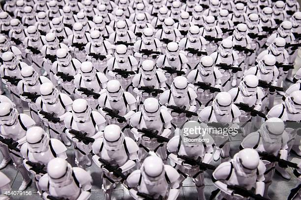 Stormtrooper figurines from the Star Wars movie franchise stand on display during the D23 Expo 2015 in Anaheim California US on Friday Aug 14 2015...