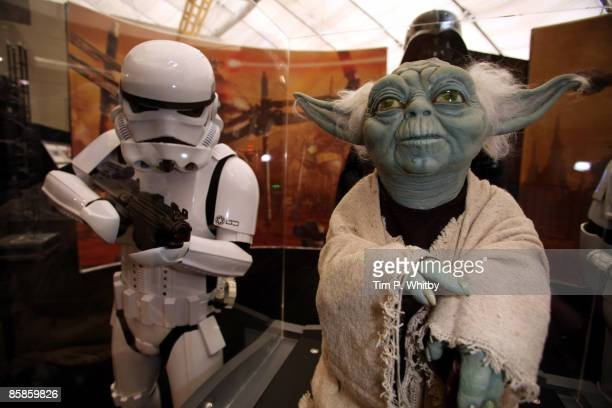 Stormtrooper from the Star Wars series of films looking at a model of Yoda at The O2 Arena ahead of the World Premiere of 'Star Wars A Musical...