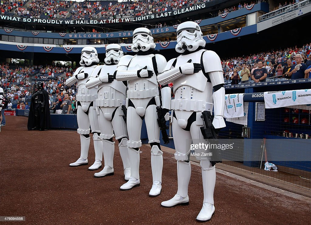 Stormtroopers and Darth Vader (left) pause for the national anthem during Star Wars Night festivities before the game between the Philadelphia Phillies and the Atlanta Braves at Turner Field on July 3, 2015 in Atlanta, Georgia.