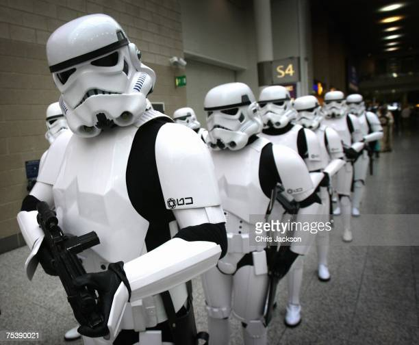 Stormtroopers file through a hallway at the Star Wars Celebration Europe in the Excel centre on July 13, 2007 in London, England. The celebration is...