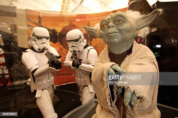 Stormtroopers from the Star Wars series of films looking at a model of Yoda at The O2 Arena ahead of the World Premiere of 'Star Wars A Musical...
