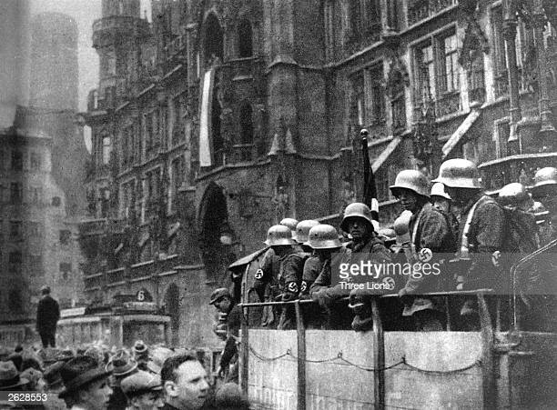 Stormtroopers in the streets of Munich as the swastika flag is hoisted on the city hall during the Putsch of 1923