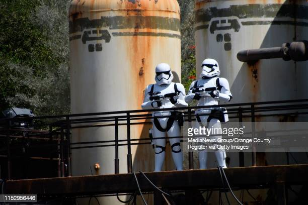 """Stormtroopers keep an eye on the inhabitants of Black Spire Outpost on opening day at Star Wars: Galaxy""""u2019s Edge at Disneyland in Anaheim, CA, on..."""