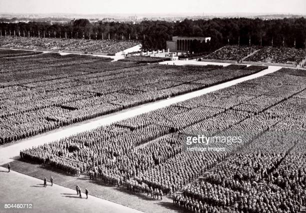 Stormtroopers lined up on parade during a Nazi Party Congress in Nuremberg Germany 1936 From Germany The Olympic Year published by Volk und Reich...