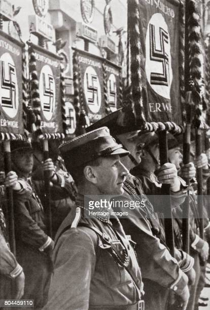 SA stormtroopers on parade Germany c19291931 Founded in c1919 the Sturmabteilung was the paramilitary wing of the Nazi party Its members were known...