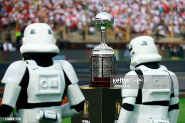 Stormtroopers walk in front of the trophy prior to the final match of Copa CONMEBOL Libertadores 2019 between Flamengo and River Plate at Estadio...