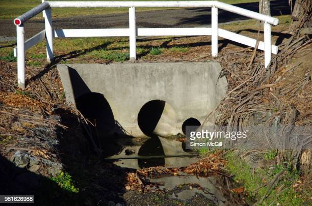 stormwater drain - ditch stock photos and pictures