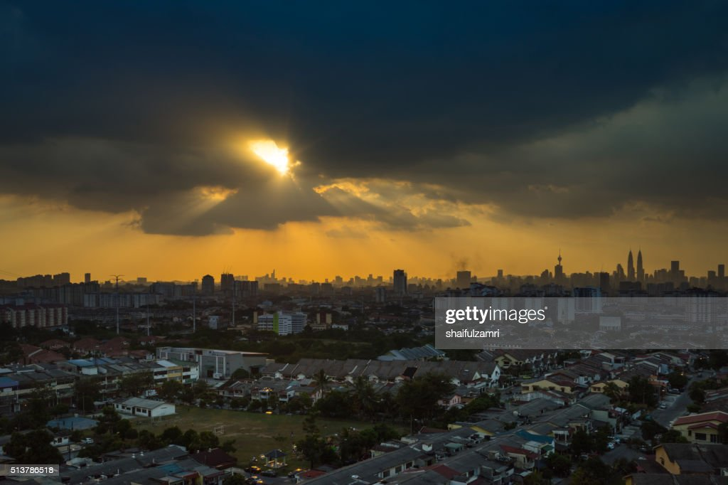 Stormy and rainy sunset in downtown Kuala Lumpur : Stock Photo