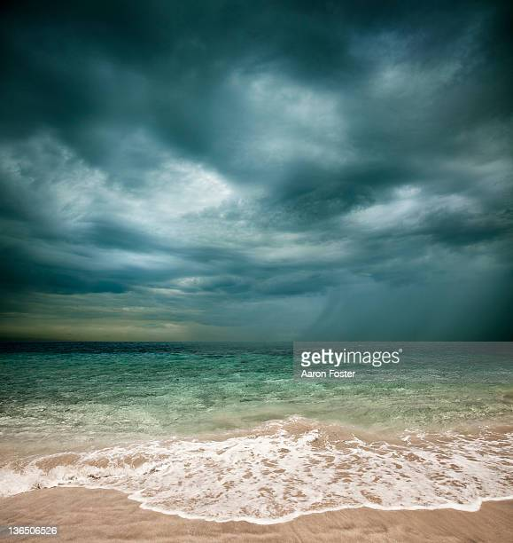 stormy beach - moody sky stock pictures, royalty-free photos & images