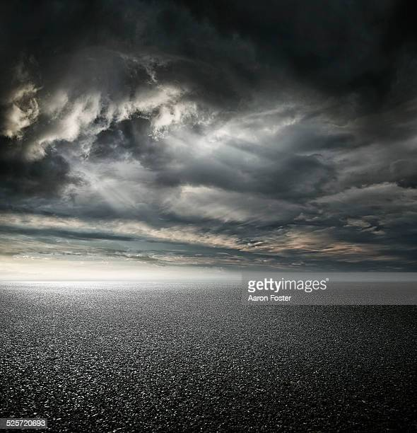stormy carpark - storm cloud stock pictures, royalty-free photos & images