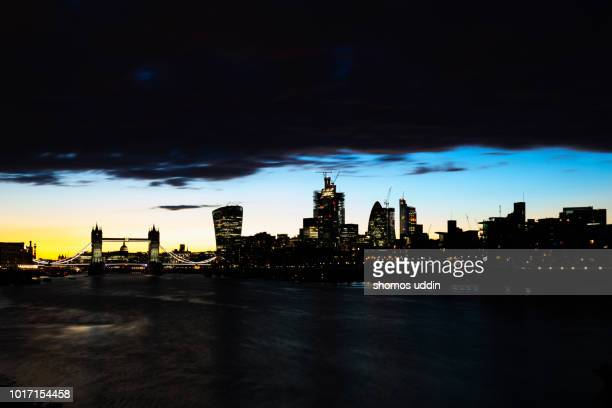 stormy cityscape at dusk - city of london stock pictures, royalty-free photos & images