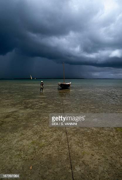 Stormy clouds and a fishing boat near the coast of Mkokotoni Zanzibar Tanzania