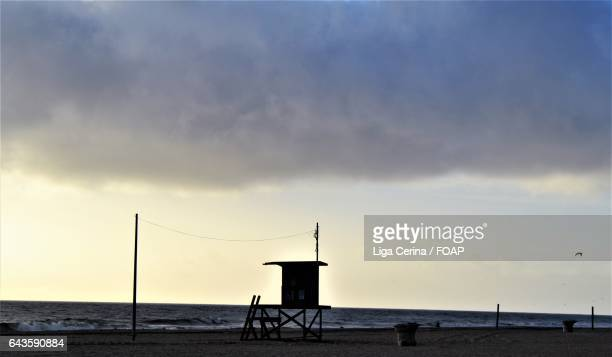 stormy clouds on beach - liga cerina stock pictures, royalty-free photos & images