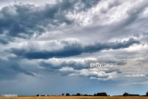 stormy clouds on ile de re, france - cielo variabile foto e immagini stock