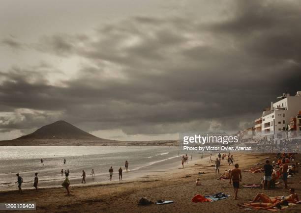 stormy clouds over el medano beach in tenerife island - victor ovies fotografías e imágenes de stock