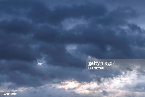 stormy clouds - storm cloud stock pictures, royalty-free photos & images