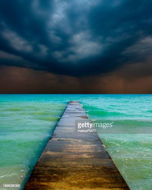 stormy cloudy sky and empty jetty