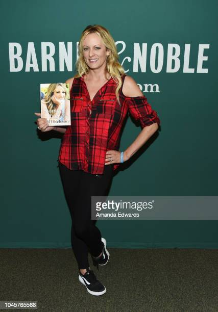 """Stormy Daniels poses after signing copies of her new book """"Full Disclosure"""" at Barnes & Noble at The Grove on October 4, 2018 in Los Angeles,..."""