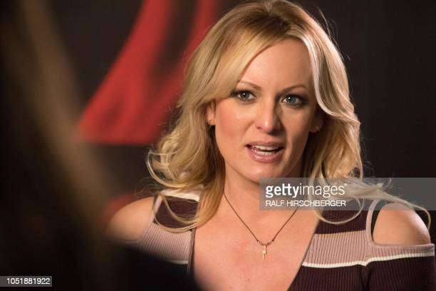 Stormy Daniels the porn star who claims to have slept with US President Donald Trump over a decade ago talks with a journalist during an interview at...