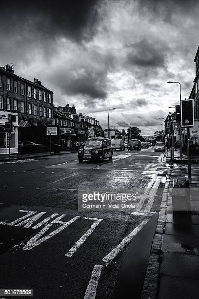 Stormy day in Edinburgh, Scotland, with a cab in the center of the image.