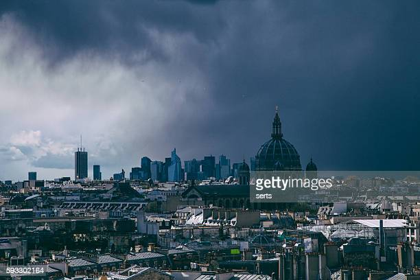 Stormy day with dark clouds in Paris city