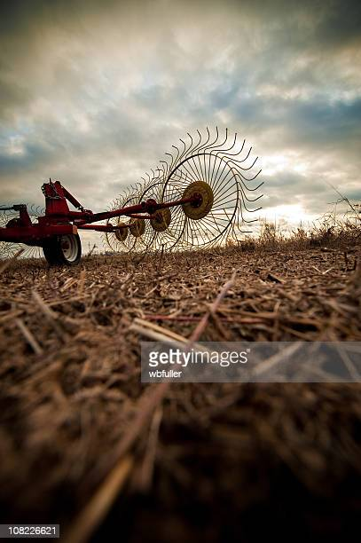stormy farm equipment - threshing stock photos and pictures