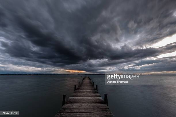 stormy lake - storm cloud stock pictures, royalty-free photos & images