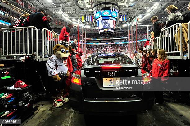 Stormy mascot for the Carolina Hurricanes looks on as the Honda for MVP Patrick Sharp of the Chicago Blackhawks is driven onto the ice after the 58th...
