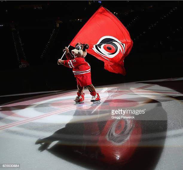 Stormy mascot of the Carolina Hurricanes waves the team logo flag prior to an NHL game against the San Jose Sharks on November 15 2016 at PNC Arena...
