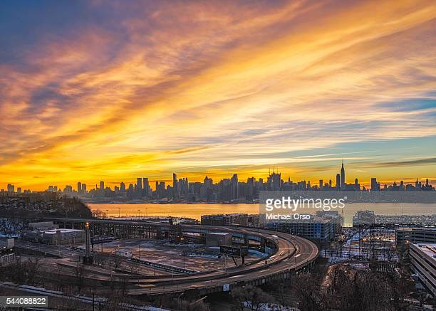 stormy morning cloudy sky sunrise. manhattan skyline from new jersey looking over hudson river and lincoln tunnel. - lincoln tunnel stock photos and pictures