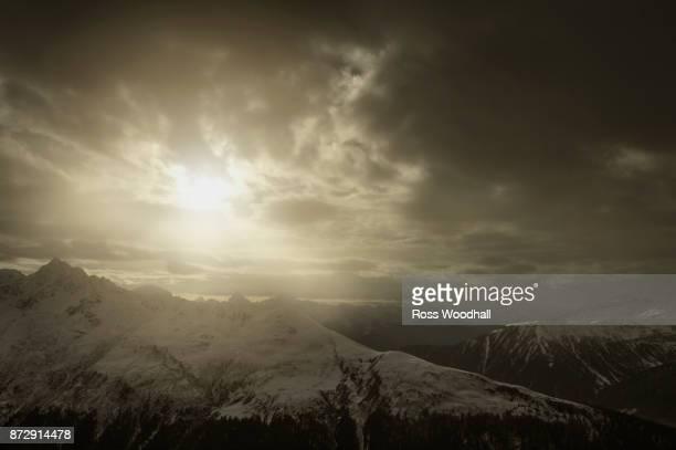 stormy mountain scene viewed from davos, switzerland. - davos stock-fotos und bilder
