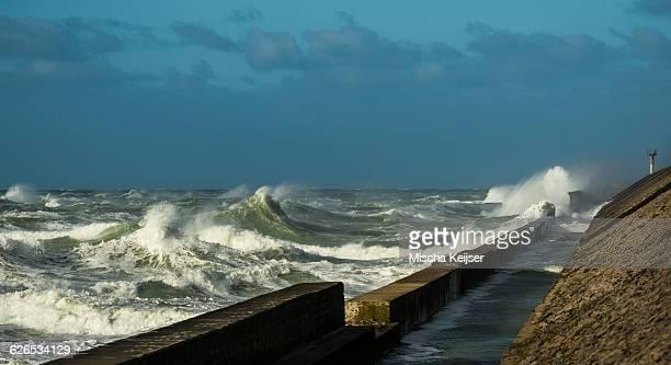 Stormy ocean waves splashing harbour wall, Boulogne-sur-Mer, Pas de Calais, France