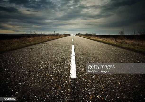 stormy road - empty road stock pictures, royalty-free photos & images