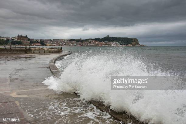 stormy sea at scarborough, north yorkshire coast - retaining wall stock pictures, royalty-free photos & images