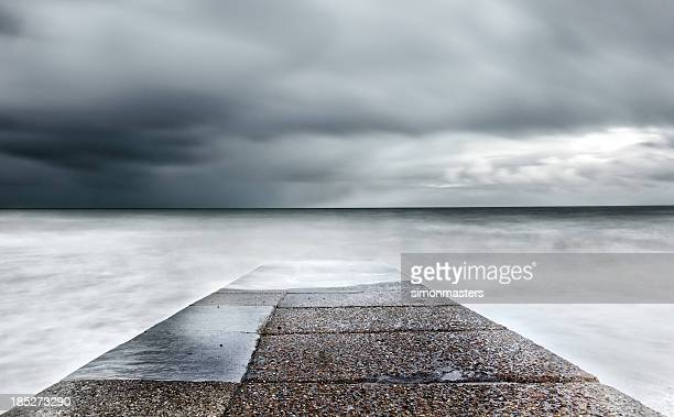 stormy sea jetty - pier stock pictures, royalty-free photos & images