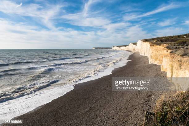 stormy seas, seven sisters chalk cliffs, east sussex - seven sisters cliffs stock photos and pictures