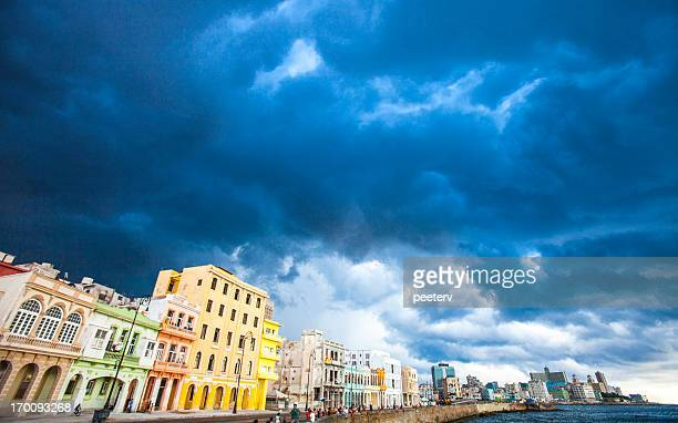 Stormy skies over colorful buildings.