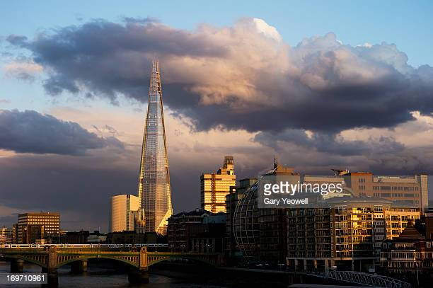 stormy sky over london city skyline - yeowell stock photos and pictures