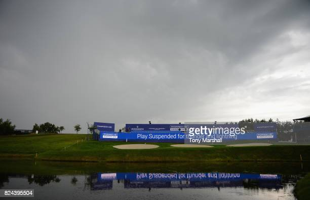 Stormy sky over the 18th green as play is suspended due to the threat of lightning during the Porsche European Open - Day Four at Green Eagle Golf...