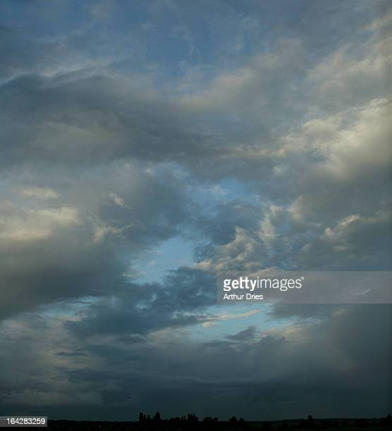 stormy sky - lucht stock pictures, royalty-free photos & images