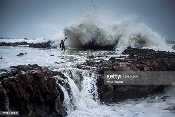 stormy spearfisherman - spear stock pictures, royalty-free photos & images