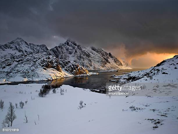 Stormy sunset over snow covered mountains, Lofoten Islands Arctic Norway