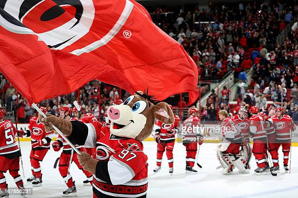 Stormy the Ice Hog mascot of the Carolina Hurricanes celebrates a Canes victory against the New York Islanders during their NHL game at PNC Arena on...