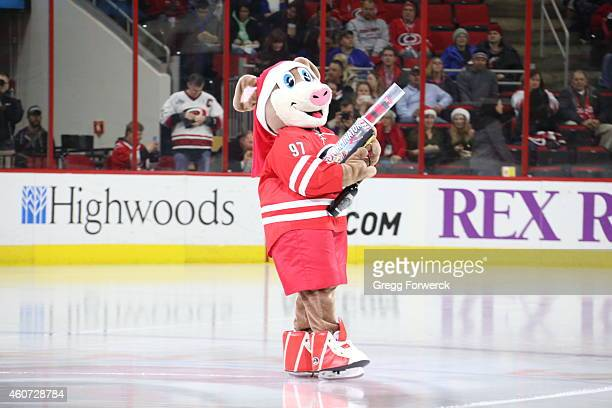 Stormy the Ice Hog prepares to shoot tshirts prior to an NHL game between the Carolina Hurricanes and the New York Rangers at PNC Arena on December...