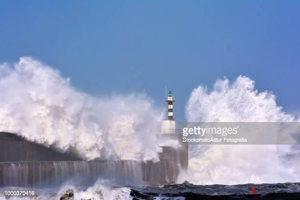 Stormy wave over lighthouse of San Esteban de Pravia.