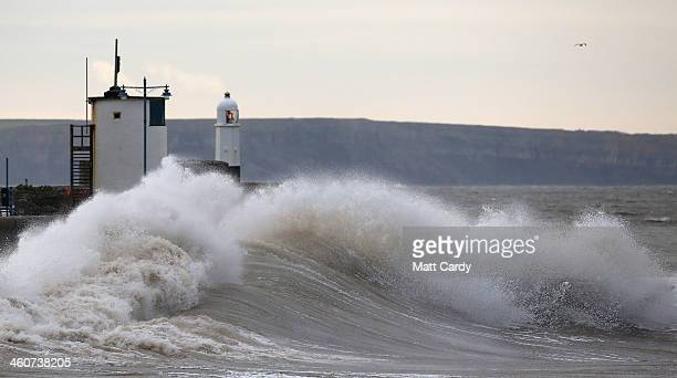 Stormy waves roll in to the shore and break along the seafront at Porthcawl on January 5 2014 in Mid Glamorgon Wales After a period of recent storms...
