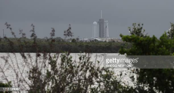 Stormy weather looms around the launch complex 39A at the Kennedy Space Center in Florida on May 26 as ready for launch is the SpaceX Falcon 9 rocket...