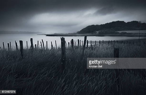 stormy weather over an estuary in brittany, france - brittany bell stock photos and pictures