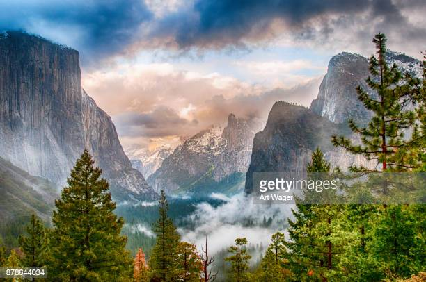 stormy yosemite valley - yosemite valley stock photos and pictures